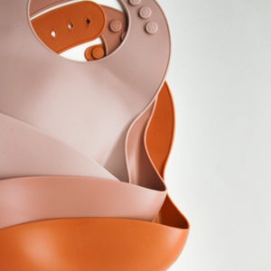 Silicone Feeding Bib in Apricot Cream - Our Story Paper Co.