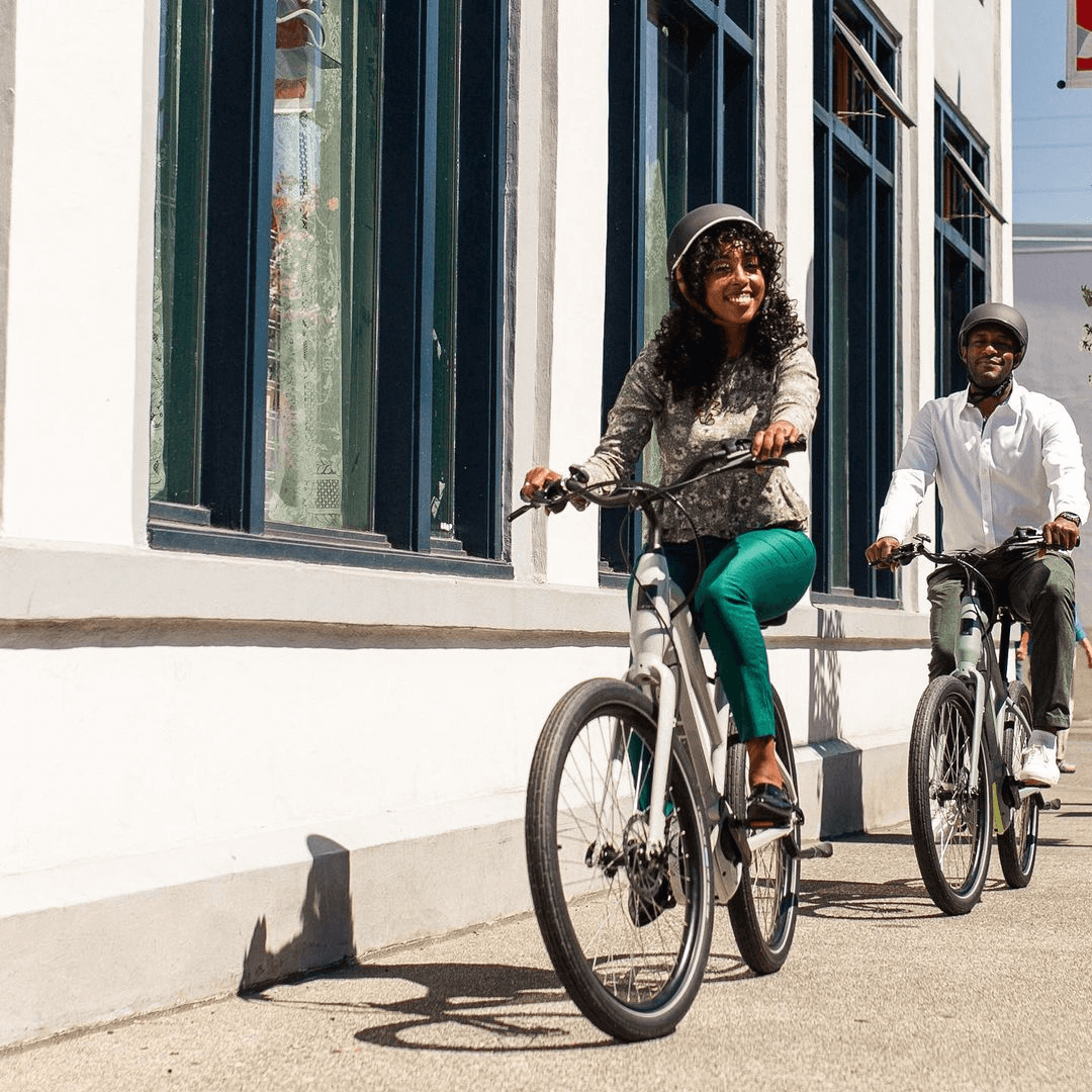people riding bikes and wearing Thousand helmets