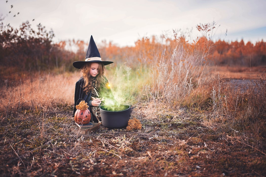 witch girl with pumpkin halloween