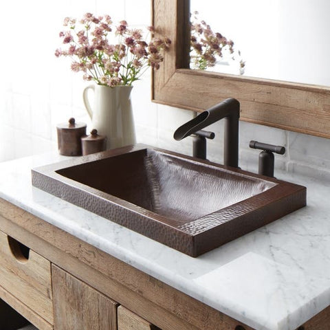 copper sink installed in a bathroom vanity