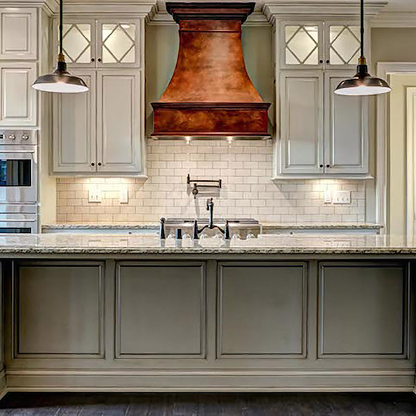 custom made copper metal range in a kitchen