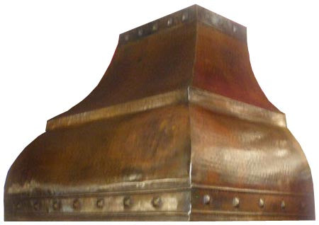 photo of mexican copper range hood hammered in a kitchen