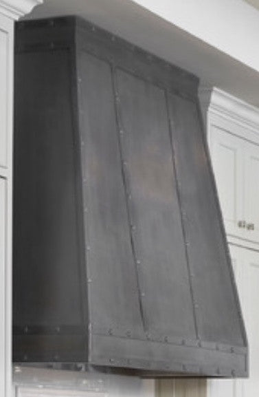 wall zinc range hood in a kitchen