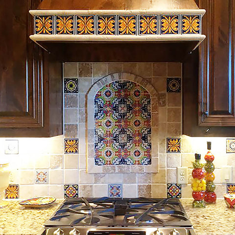 painted ceramic tile mural from Mexico installed on a kitchen backsplash wall