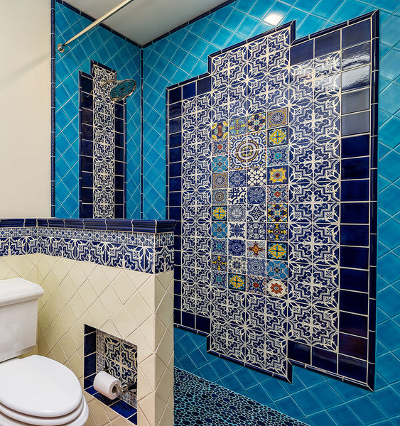 hand painted mexican tiles decorating interior walls