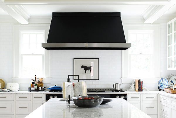 custom made island range hood in a kitchen