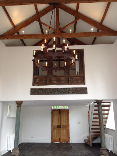medieval style iron chandelier illuminating a living room