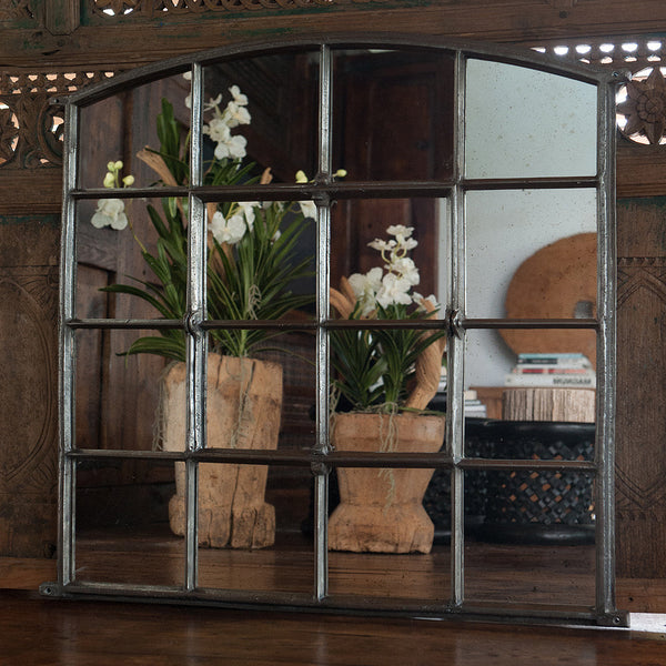 colonial wrought iron mirror frame on a wall
