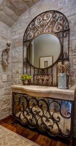 wrought iron mirror hang on the foyer wall