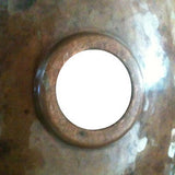 back view of copper bathroom sink hammered in round shape