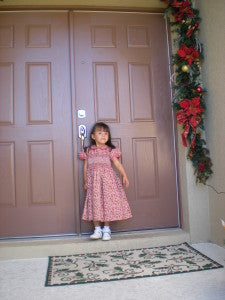 Silvana looks very elegant wearing Carouselwear Smocked Strawberry Yoke dress.