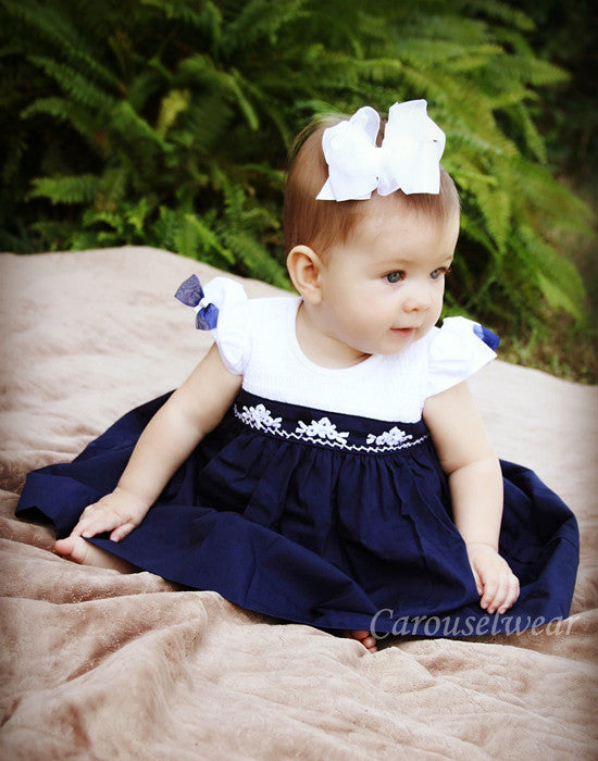 elegant lisa smocked girls christmas dress in navy and white carousel wear 1