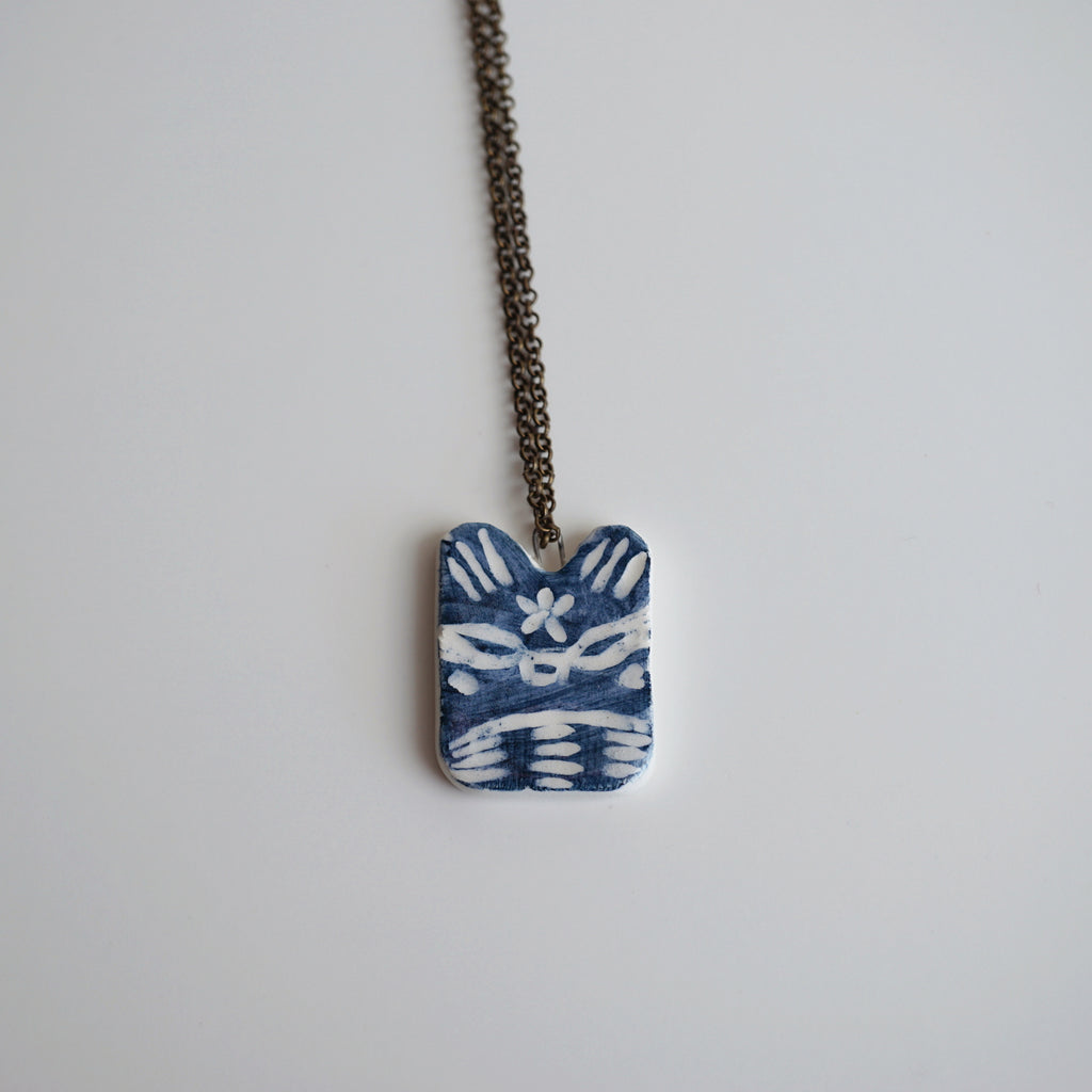 Blue Raccoon Necklace