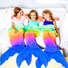 3 girls in Blankie Tails mermaid tail blankets on a couch