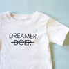 Dreamer - Baby Tee - FOR BETTER NOT WORSE Fashion That Gives Back Ending Child Hunger In The US