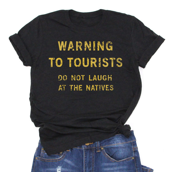 Warning to Tourists, Do not Laugh at the Natives -Graphic Tee -Unisex Modern Fit