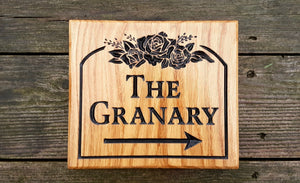 Square House Sign the grannary with an arrow and rose scroll FONT: LATIENNE
