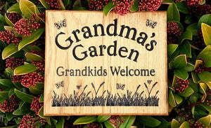 Square House Name Plate saying grandmas garden grandkids welcome with a grass and butterfly picture FONT: EDWARDIAN