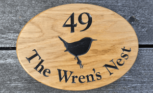280x200mm Oval Number House Sign with 49 The Wrens Nest and Wren engraved onto the sign.
