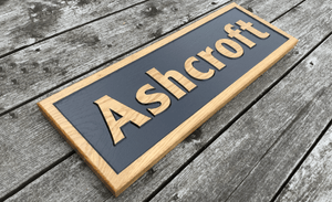 Ashcroft 600 x 220mm Reverse Engraved Solid Oak House Sign FONT: CENTURY