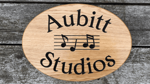 Aubitt Studios musical note oval shaped sign