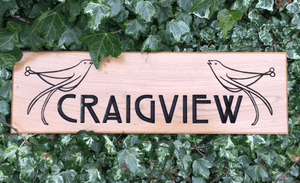 Craigview two birds Perched on engraved text solid oak house sign
