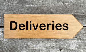 Deliveries Sign pointing towards the right