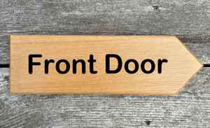 Front Door Sign pointing towards the right