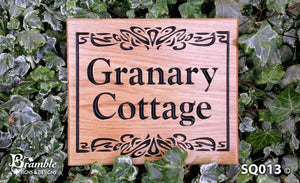 Square House Name Plate saying granary cottage with a boarder and scroll FONT: GOUDY OLD