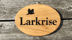 Larkrise Lark bird design house sign.