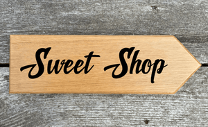 Sweet Shop Sign pointing towards the right