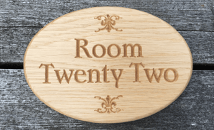 Room Twenty Two Solid Oak Oval Sign for Hotels, Convention centres, Bed & Breakfast room number sign