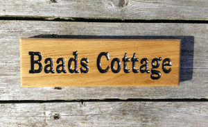 Small Thin House Sign saying baads cottage FONT: BOOKMAN
