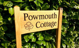 medium ladder sign engraved with powmouth cottage and an ouk tree