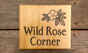 Square House Sign saying wild rose corner with a flower picture FONT: EDWARDIAN