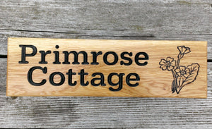 Small Thin House Name Plate saying primrose cottage with a primrose picture FONT: BOOKMAN
