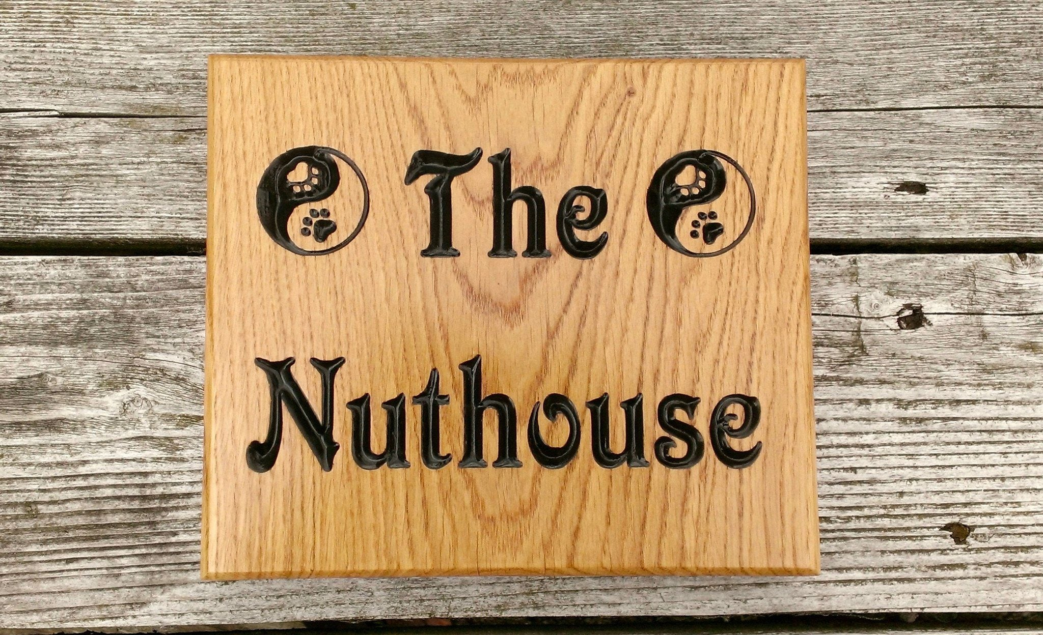 Square house name plate engraved with the nuthouse and two peace signs font victorian
