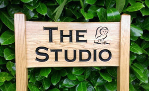 Medium Ladder Sign with the studio and an owl engraved on it