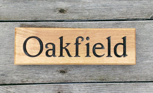 Small Thin House Sign saying oakfield FONT: EDWARDIAN