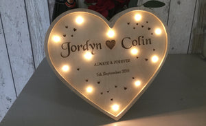 Heart Shaped Light Box Lit Up With Golden Glow