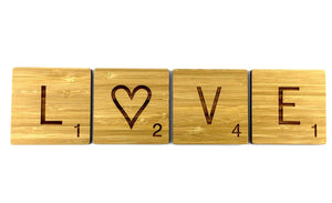 L O V E scrabble tiles with a Love heart instead of an O