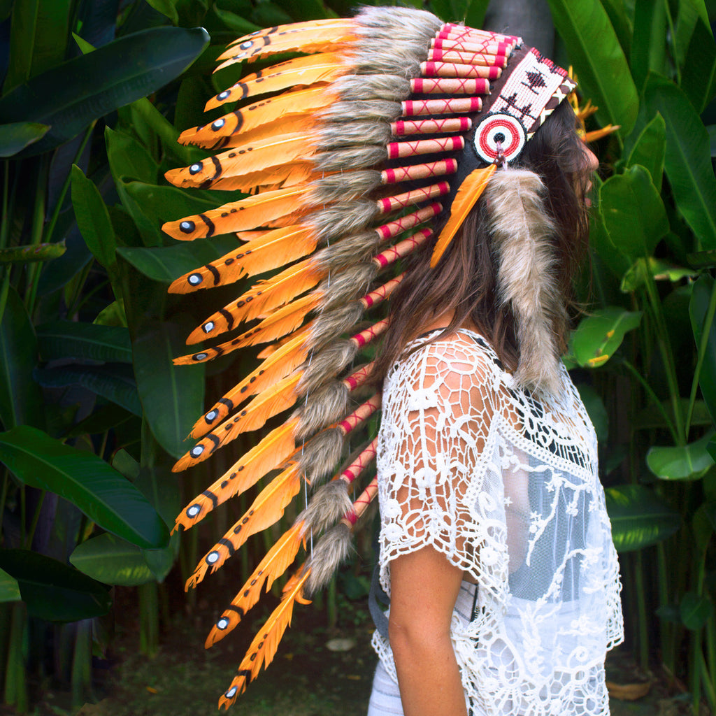 Long native american style headdress with orange duck feathers