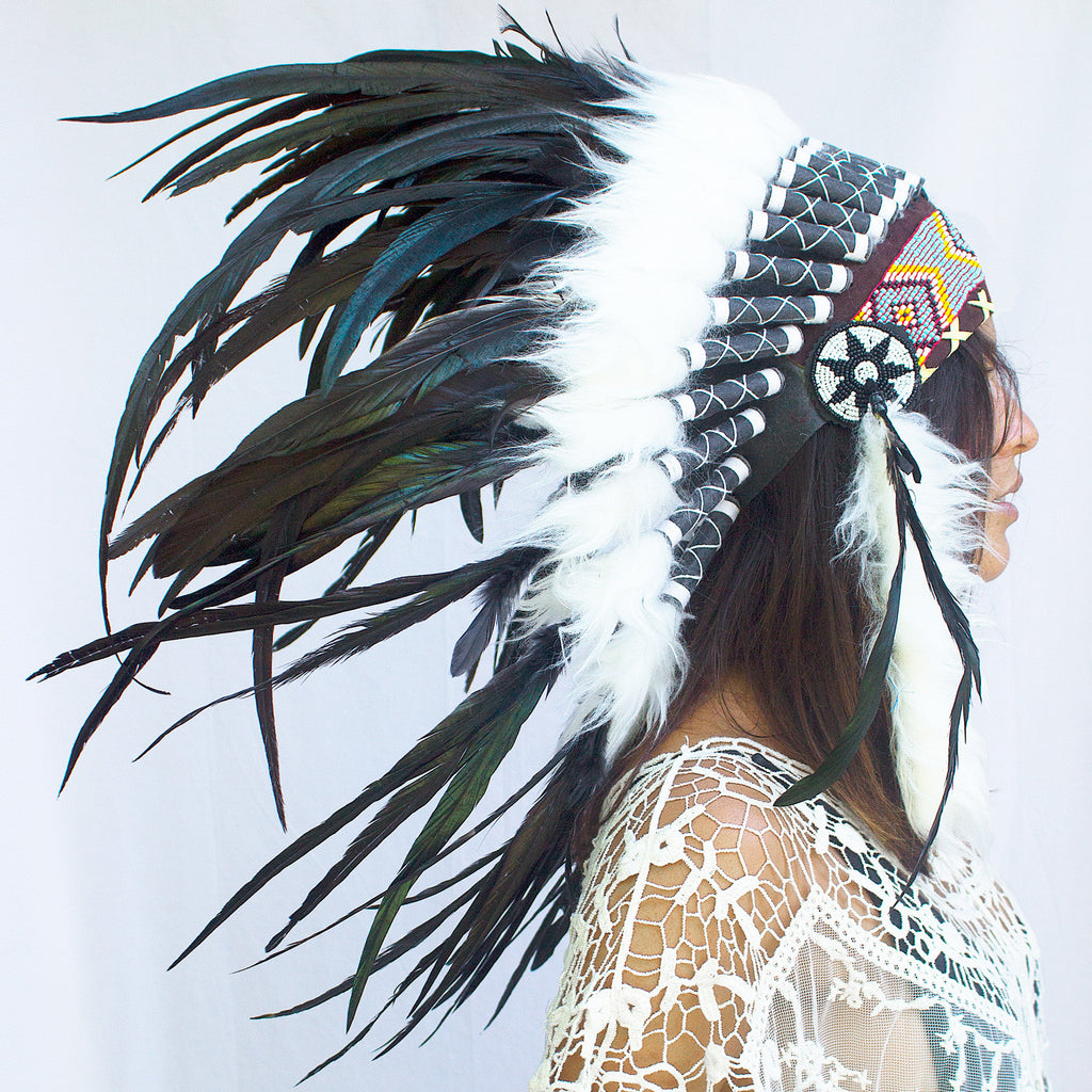 photo of a girl wearing a short black native american headdress with beads, leather, and natural black rooster feathers, for men, for women, or for children, available for purchase from the sounding iron with shipping from the united states