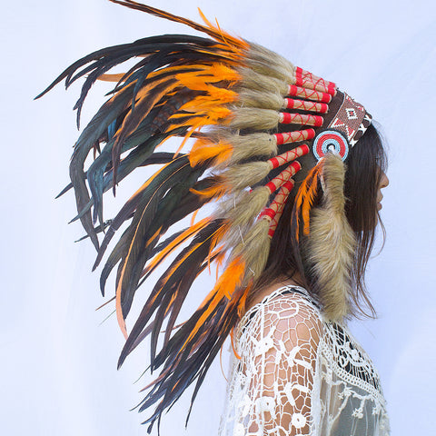 photo of a girl wearing a short orange indian headdress with beads, leather, and orange rooster feathers, for men, for women, or for children, available for purchase in the united states from the sounding iron