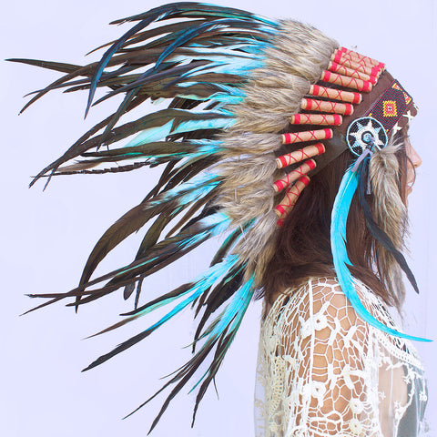 photo of a girl wearing a short turquoise native american headdress with beads, leather,  and light blue rooster feathers, for men for women or for children, available for purchase from the sounding iron with shipping from the united states