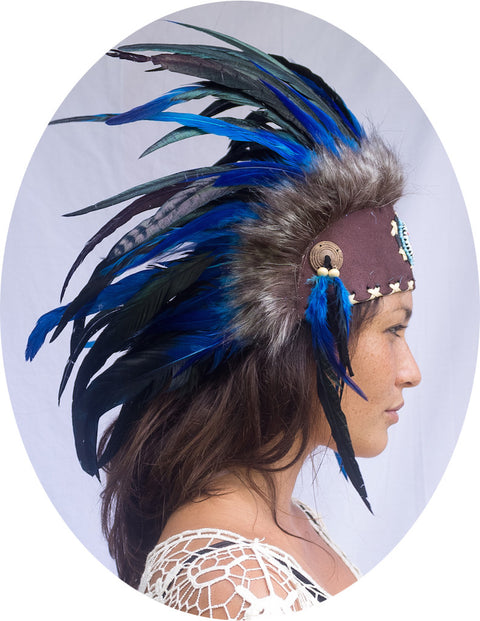 photo of a girl wearing a small blue native american inpired headdress with beads and blue rooster feathers, for men or for women or for children, available for purchase from the sounding iron with shipping from the united states