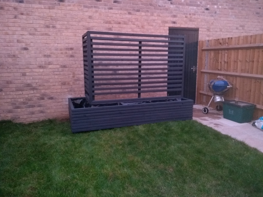 Block Style Corner Wooden Planters With Spaces Between The Rows With