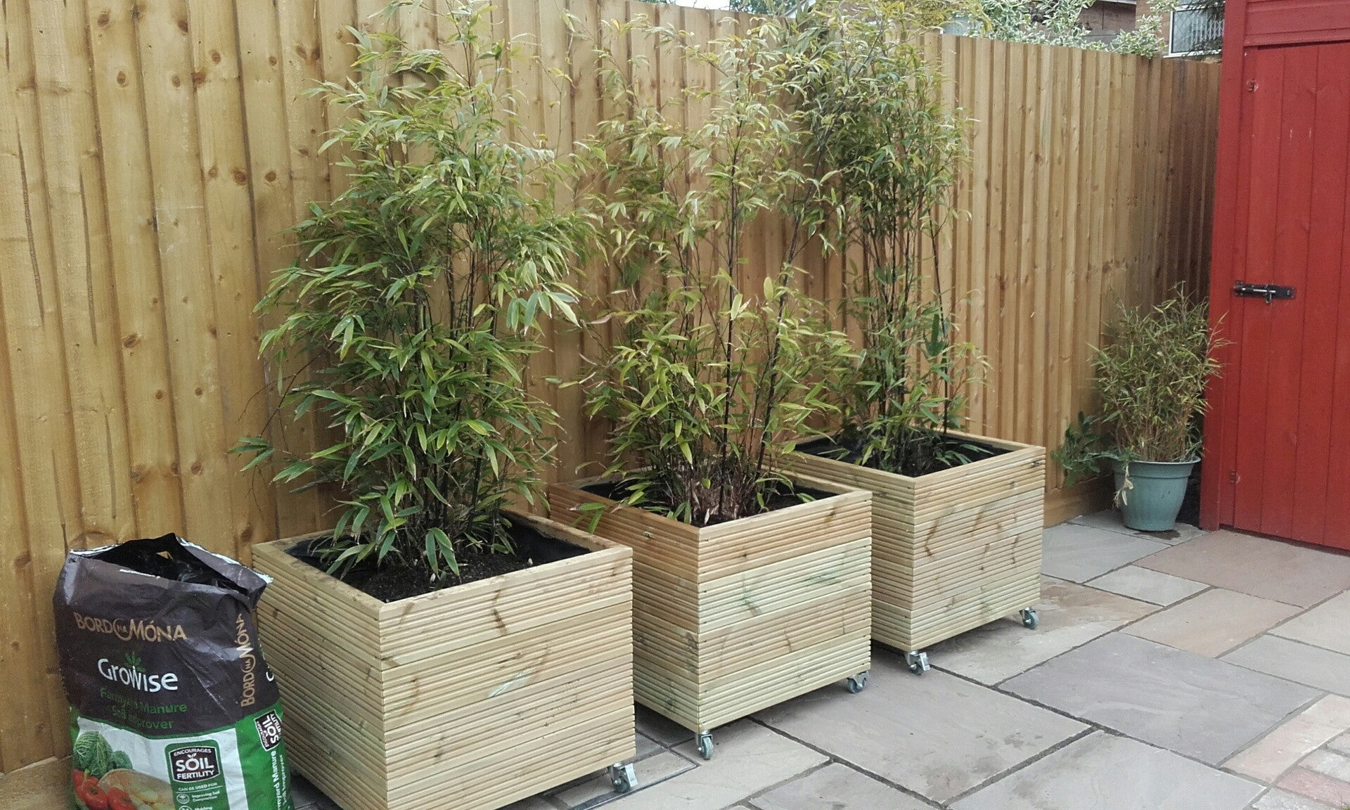 Image of: Wooden Planters On Wheels Casters Square Wooden Planter 4 Rows Of Premier Wooden Planters