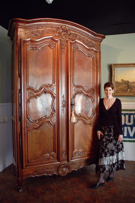 Renee stands by the recently acquired wanut Louis XV armoire (c. 1735)