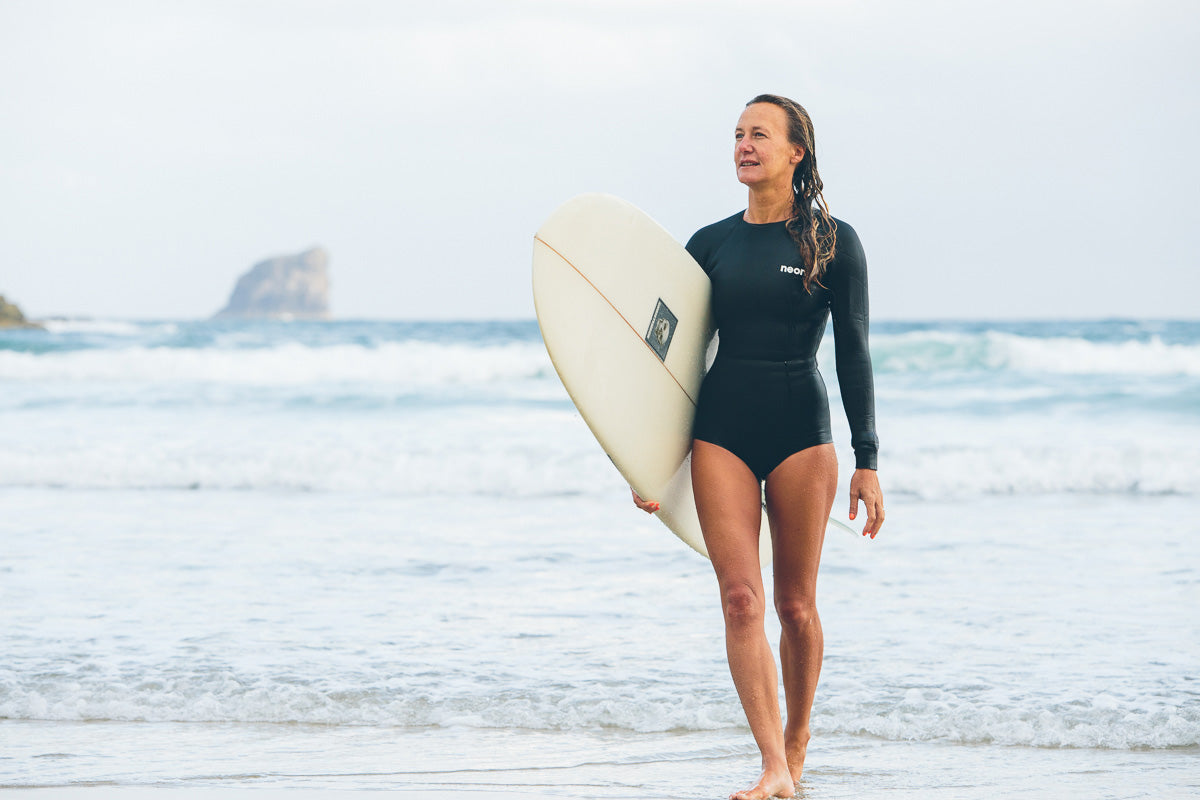 Andras Spring Suit by Neon Wetsuits with surfboard